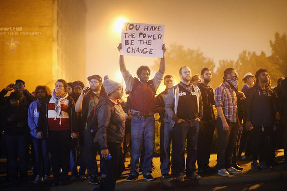 Demonstrators march through the streets Oct. 13 in St Louis, Missouri, to protest the Aug. 9 killing of 18-year-old Michael Brown by a police officer in suburban Ferguson and Vonderrit Myers Jr. in St. Louis.