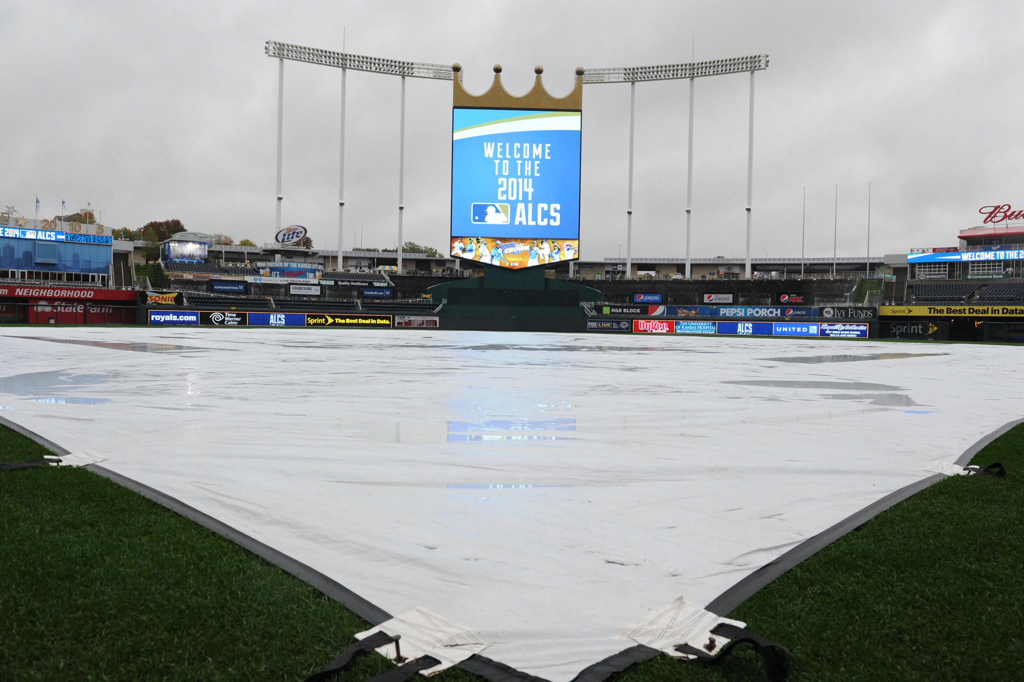 The tarp remains on the field at Kauffman Stadium as Game 3 of the American League Championship Series between the Orioles and the Kansas City Royals was postponed because of rain.