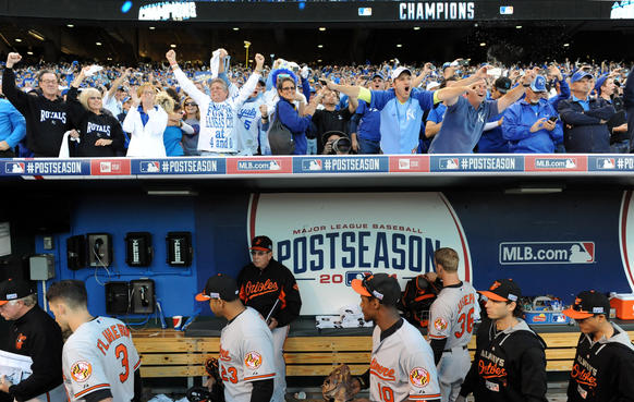 Orioles players walk out of the dugout as Kansas City Royals fans celebrate above them after Game 4 of the American League Championship Series at Kauffman Stadium.