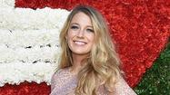 Spotted: Blake Lively shows off growing baby bump at awards event