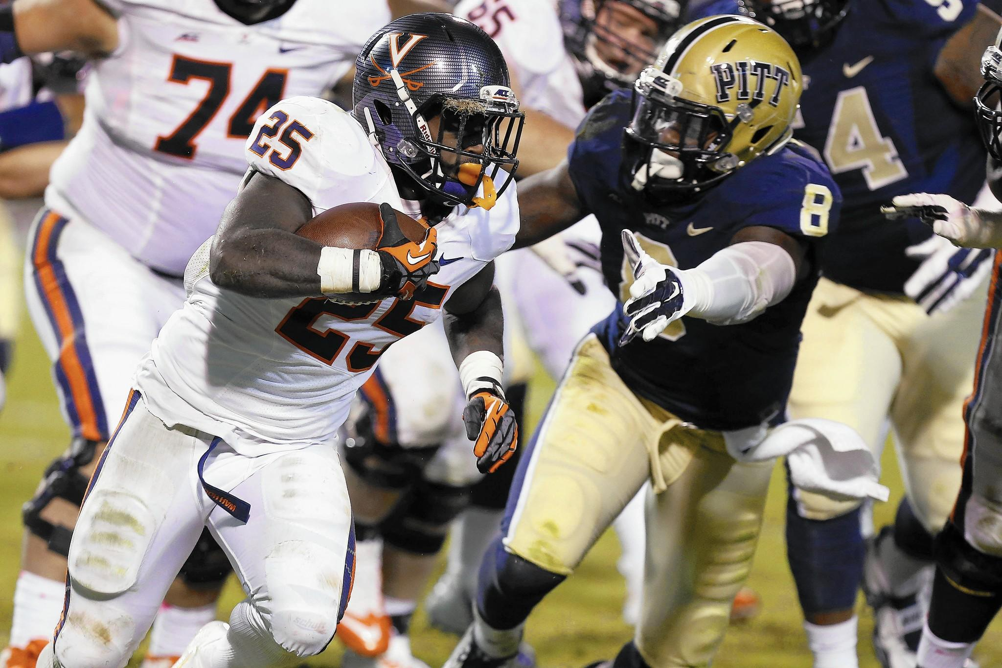 Virginia running back Kevin Parks carries the ball as Pittsburgh linebacker Todd Thomas defends Oct. 4 in Charlottesville.