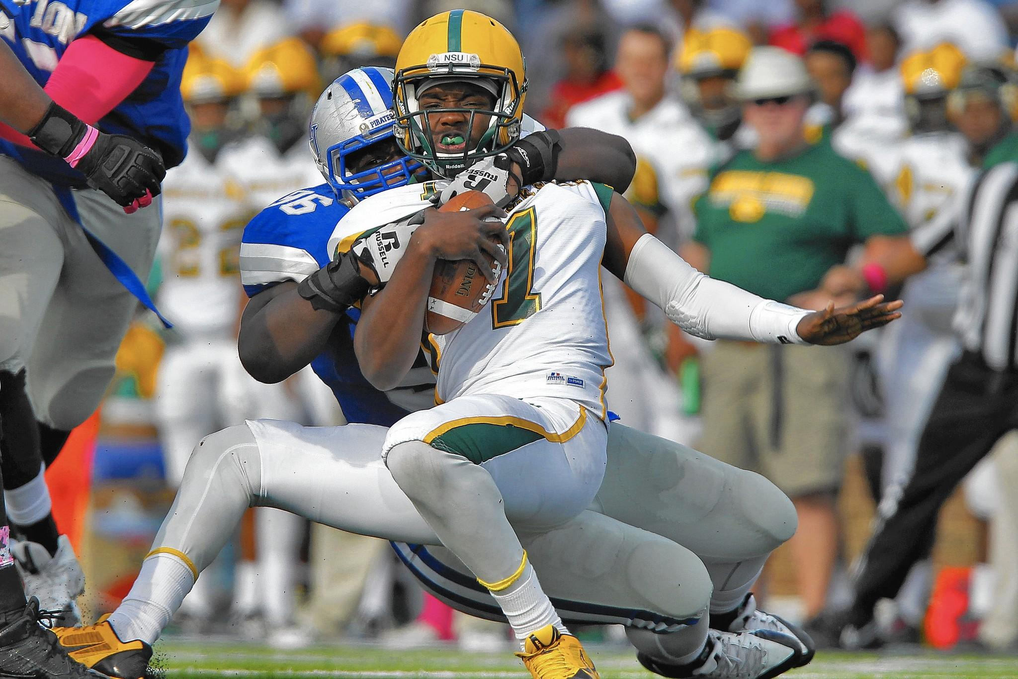 Hampton's Charles Owens, left, sacks Norfolk State quarterback Terrance Ervin during Saturday's game at Armstrong Stadium.