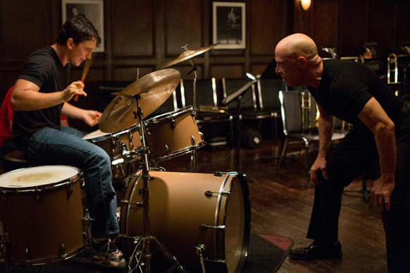 """<i> ***1/2 (out of four)</i><br> <b>What we said:</b> """"In a bracing, complex turn that better earn a best supporting actor nomination, Simmons makes a terrifying jazz drill sergeant and one of the year's best villains."""" <i>-- Matt Pais </i><br><br><a target=""""_blank"""" href=""""http://www.redeyechicago.com/entertainment/movies/redeye-practice-makes-bloody-in-whiplash-20141010,0,7202961.column""""<b>Click here for our full review</a>"""