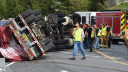 Overturned truck, spilled materials closes Md. 27