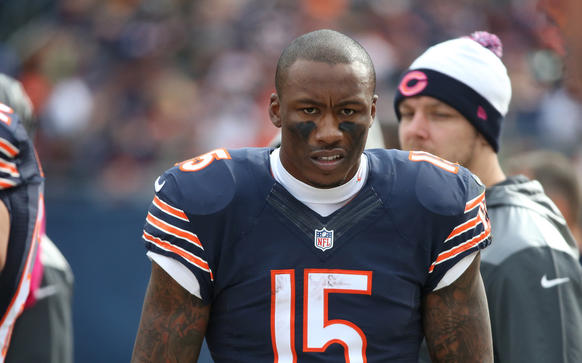 Bears wide receiver Brandon Marshall walks the sidelines in the