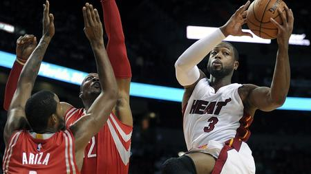 Heat guard Dwyane Wade goes into attack mode Tuesday against the Rockets at AmericanAirlines Arena.