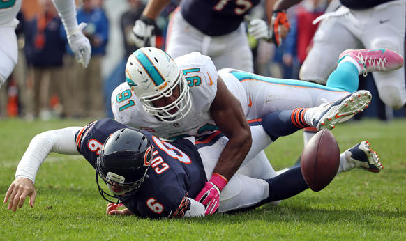 Dolphins defensive end Cameron Wake strips the ball from Bears quarterback Jay Cutler for a sack and fumble in the fourth quarter.