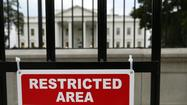 White House fence jumper charged; dogs cleared for duty
