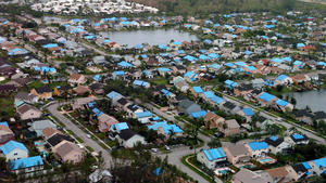 Blue tarps, signifying roof damage, were spread across South Florida, following Hurricane Wilma.