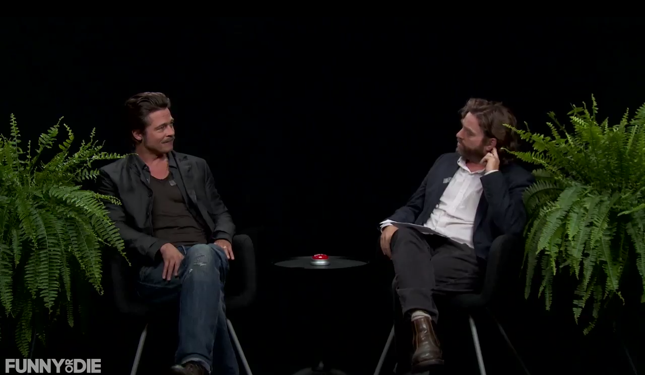 brad pitt spits in galifianakis face during between two