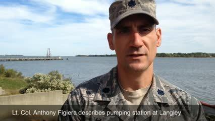 Lt. Col. Figiera on pumping station at Langley