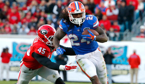 Florida running back matt jones eludes georgia linebacker reggie