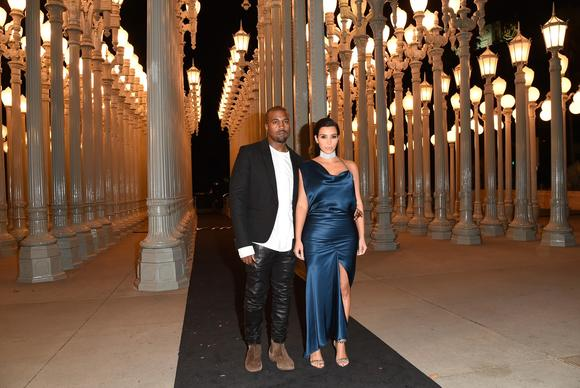 Kim Kardashian and Kanye West attend the 2014 LACMA Art   Film gala in Los Angeles. Kim Kardashian is wearing a Cushnie et Ochs gown and a Cartier choker.
