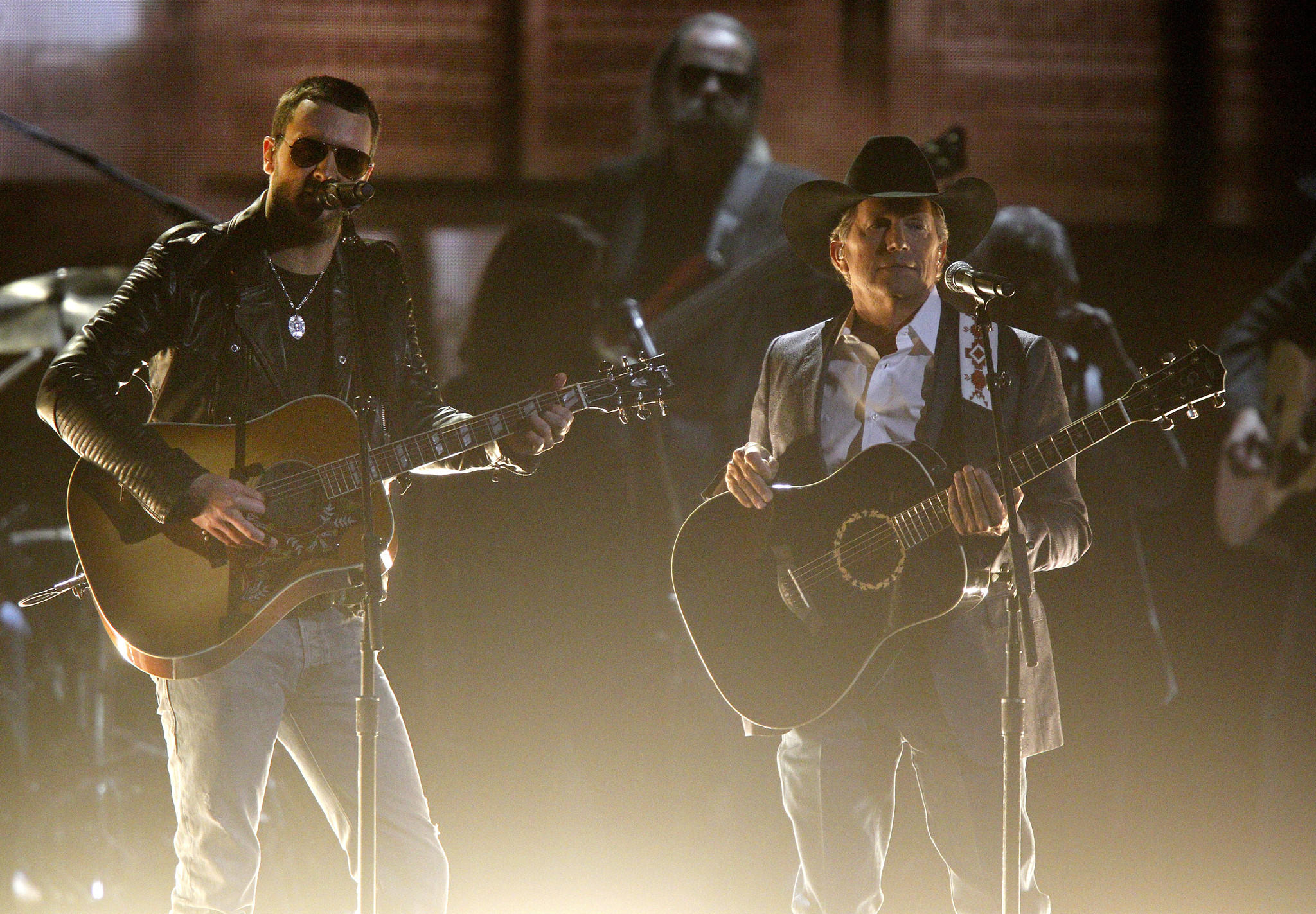 George Strait, right, is scheduled to perform live on the Hand in Hand benefit Tuesday night. The fundraiser has been expanded to include devastation from Hurricane Irma. (Wade Payne / Invision/Associated Press)