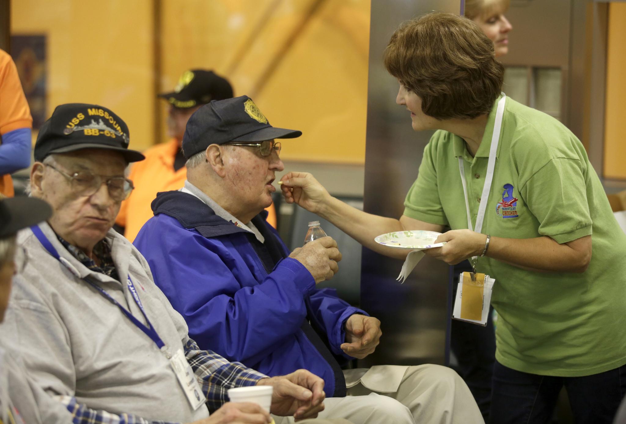 Honor flight volunteers make every day Veterans Day