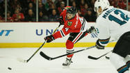 Blackhawks let Sharks back in game, then put them away