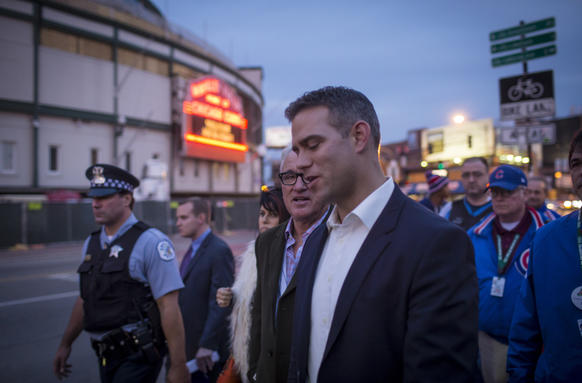 New Cubs manager Joe Maddon departs a press conference with Theo Epstein along Clark Street.