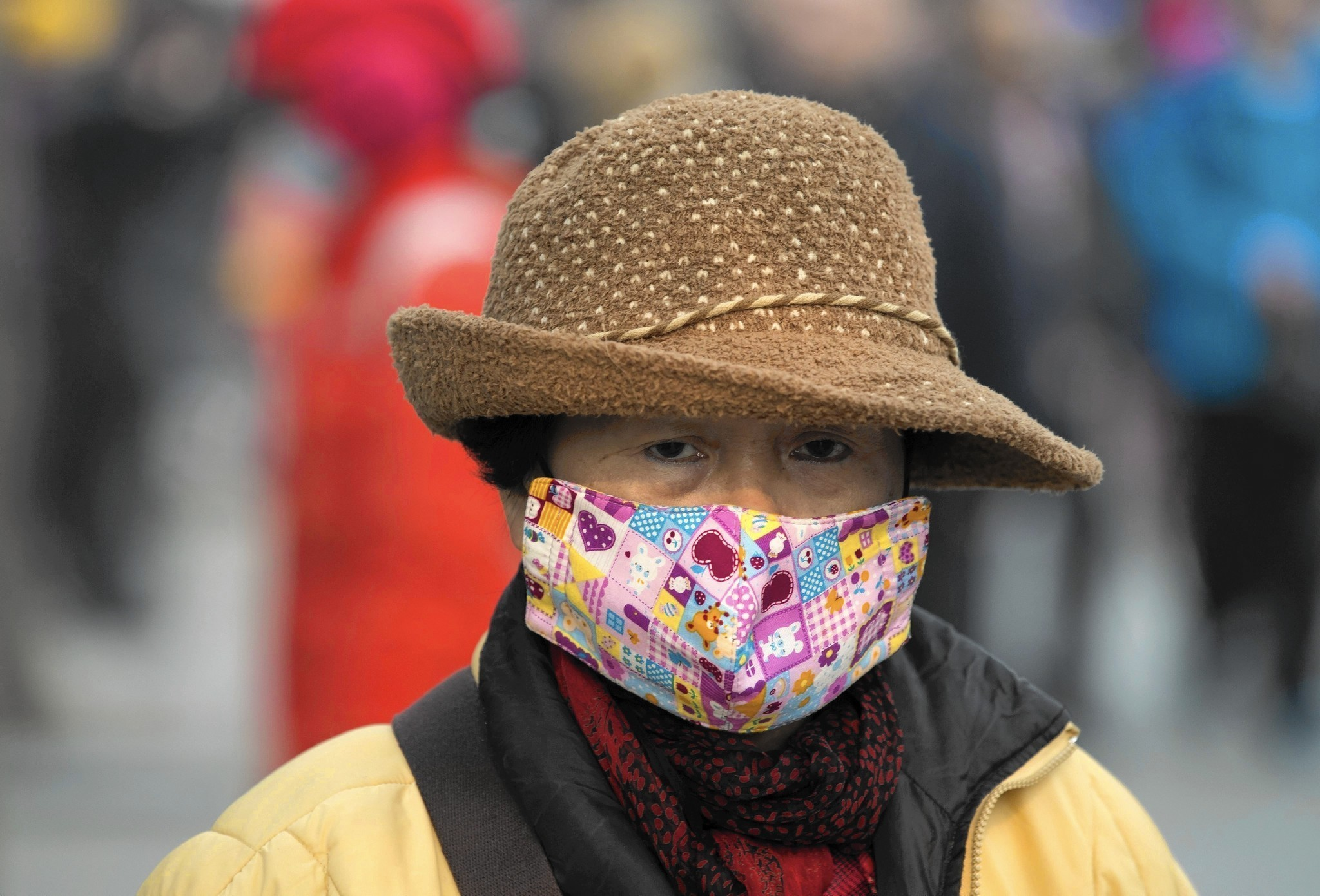 In smoggy China, masks become stylish accessory