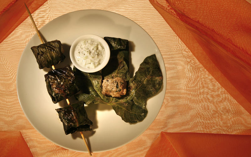 Grilled lamb meatballs in fig leaves