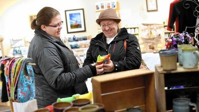 Shoppers check out handmade items at Gallery of Gifts