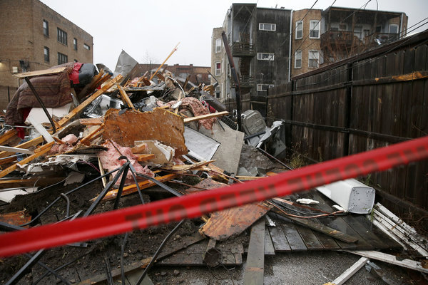 Crews rescue 2, dog trapped in rubble of collapsed South Side building