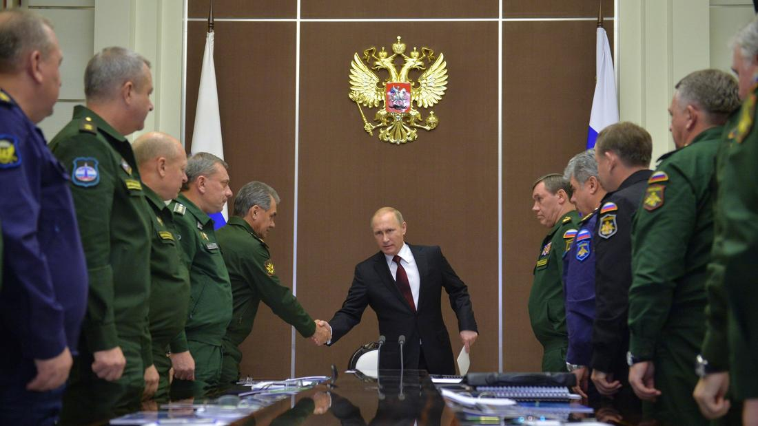 Russia's Vladimir Putin and Sergei Shoigu