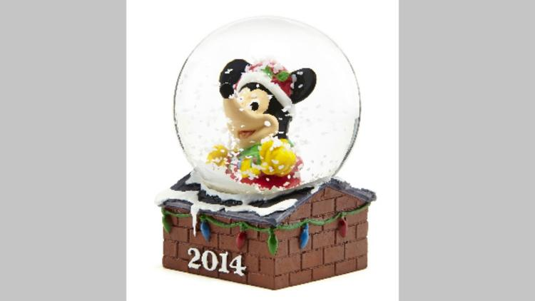 JC Penney will hand out free Mickey Mouse snow globes at its Thanksgiving opening.