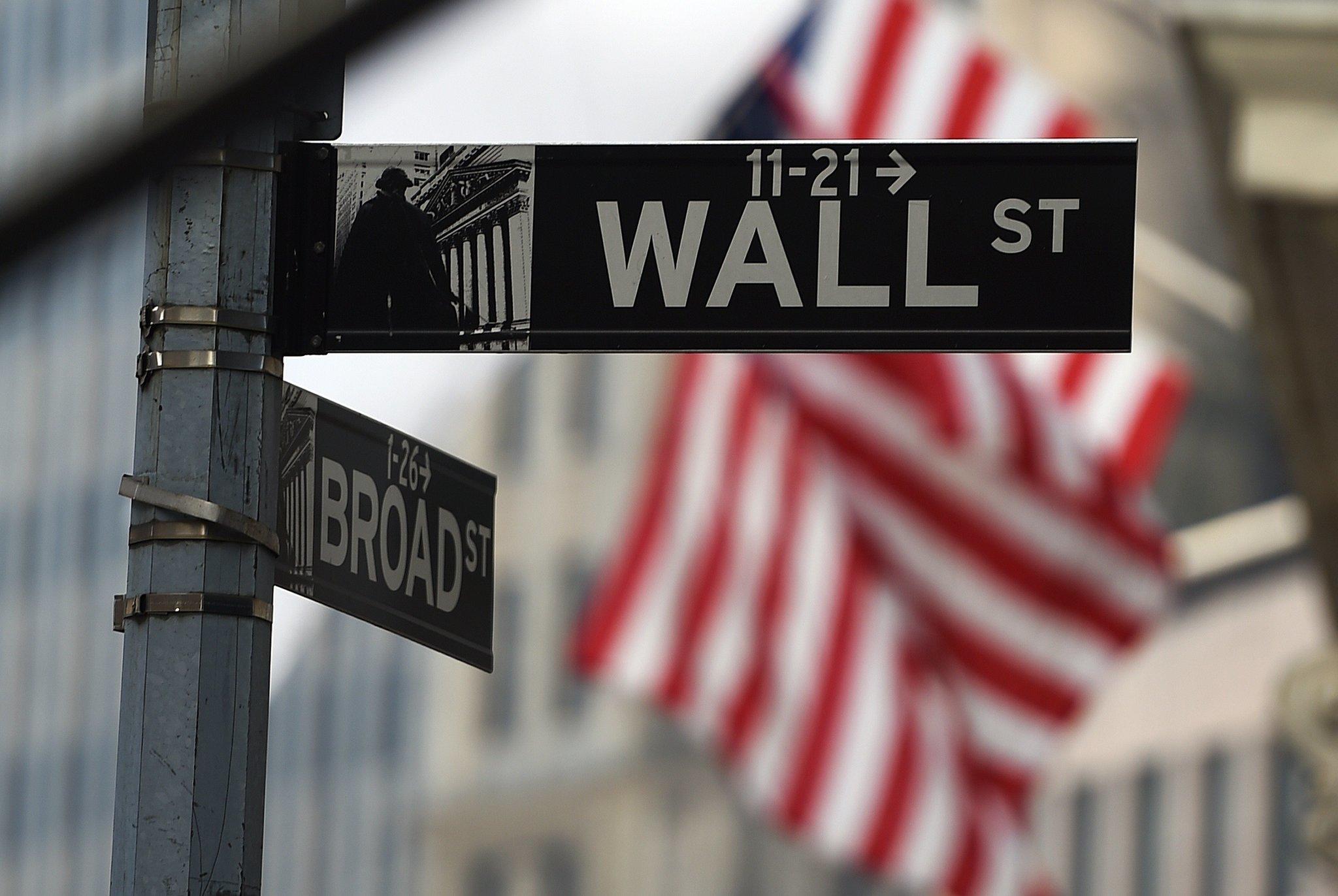 US stocks open little changed; Deere slumps