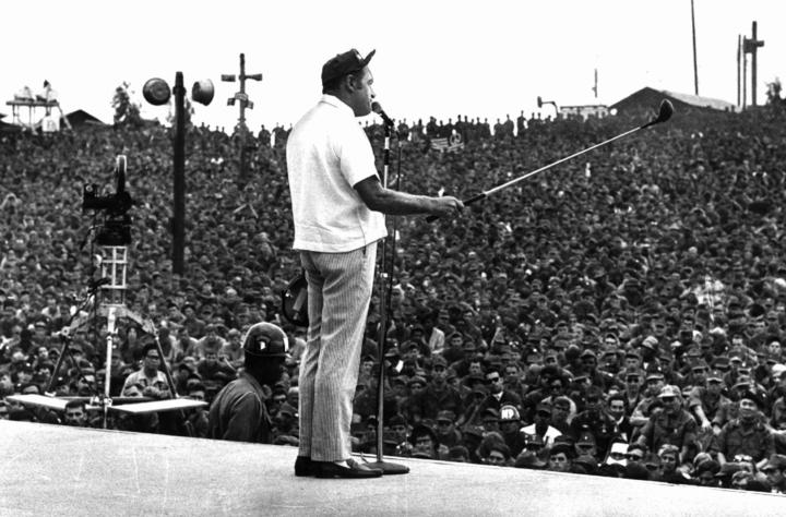 Bob Hope cracks jokes to an audience of thousands of GIs massed in an open-air theater in Cu Chi, 20 miles northeast of Saigon, during a 1969 Christmas tour of Vietnam.