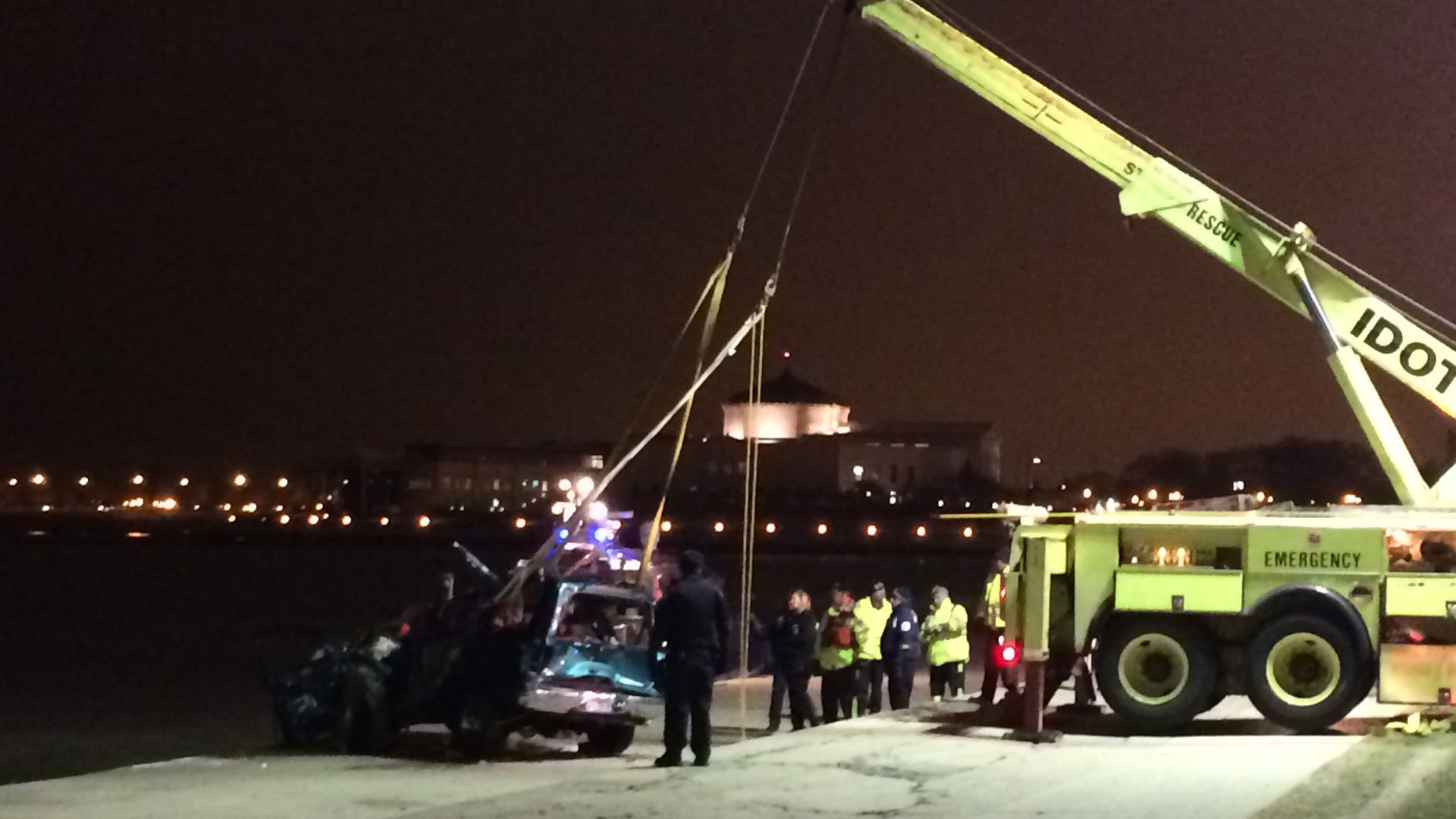 Officials: Man drives SUV in reverse from LSD into Lake Michigan