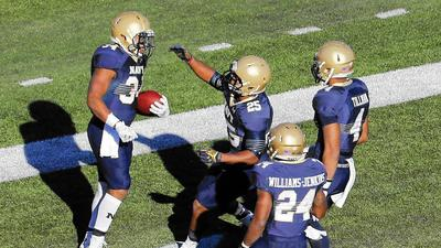 Reynolds leads Navy past South Alabama to clinch bowl berth