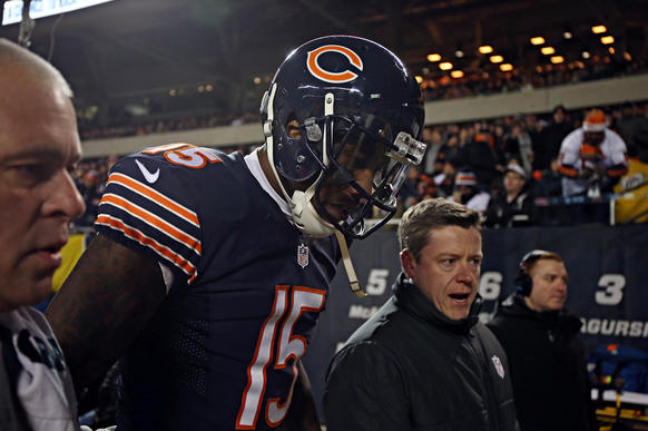 Brandon Marshall leaves the field with an injury in the second quarter against the Cowboys.
