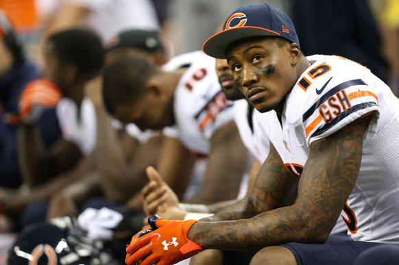 Brandon Marshall sits on the bench late in the fourth quarter.