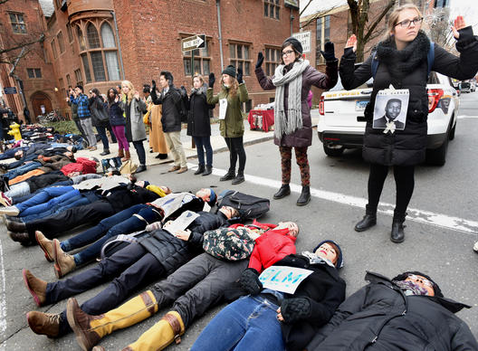 Yale law students led a die-in protest to reaffirm the value of black lives. Hundreds of protesters, holding hands, spread along Wall Street from the Yale Law School to Superior Court before rallying again around the courthouse.