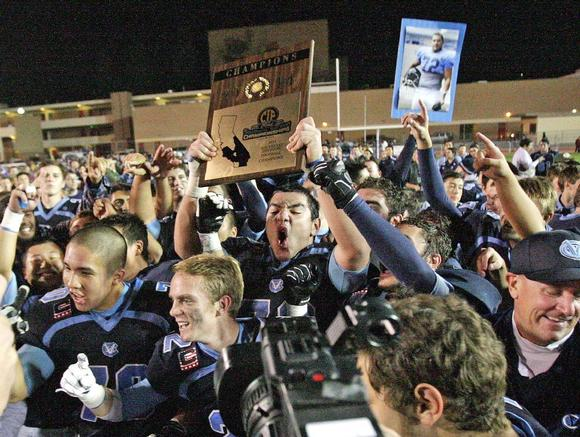 football team celebrates winning the CIF Southern Section Championship