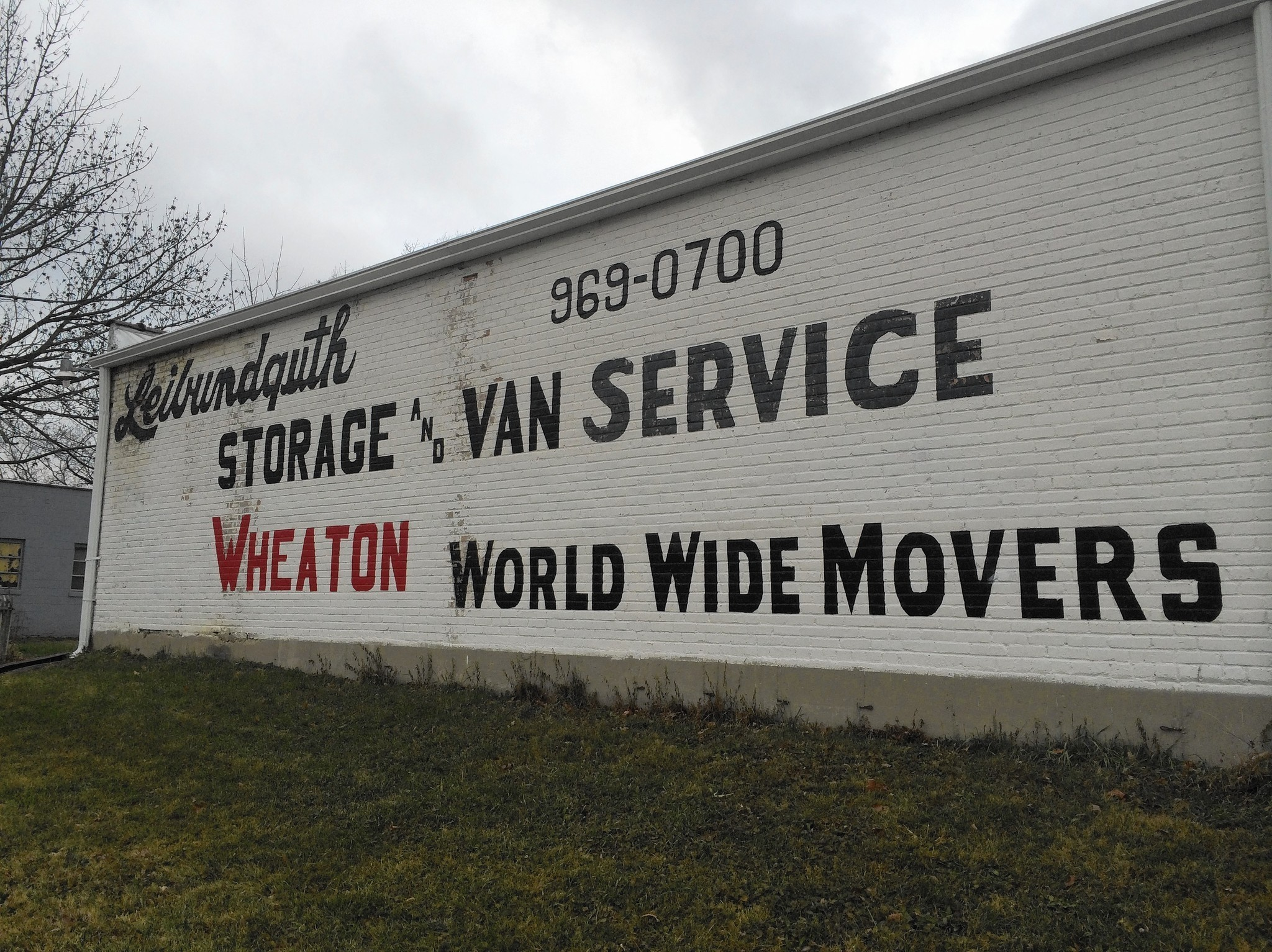 Businessman Sues Downers Grove To Keep Signs Painted On His Building    Chicago Tribune
