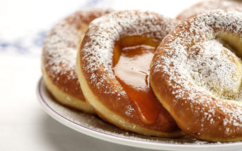 Bauernkrapfen with powdered sugar