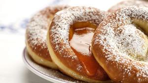 Bauernkrapfen with powdered sugar