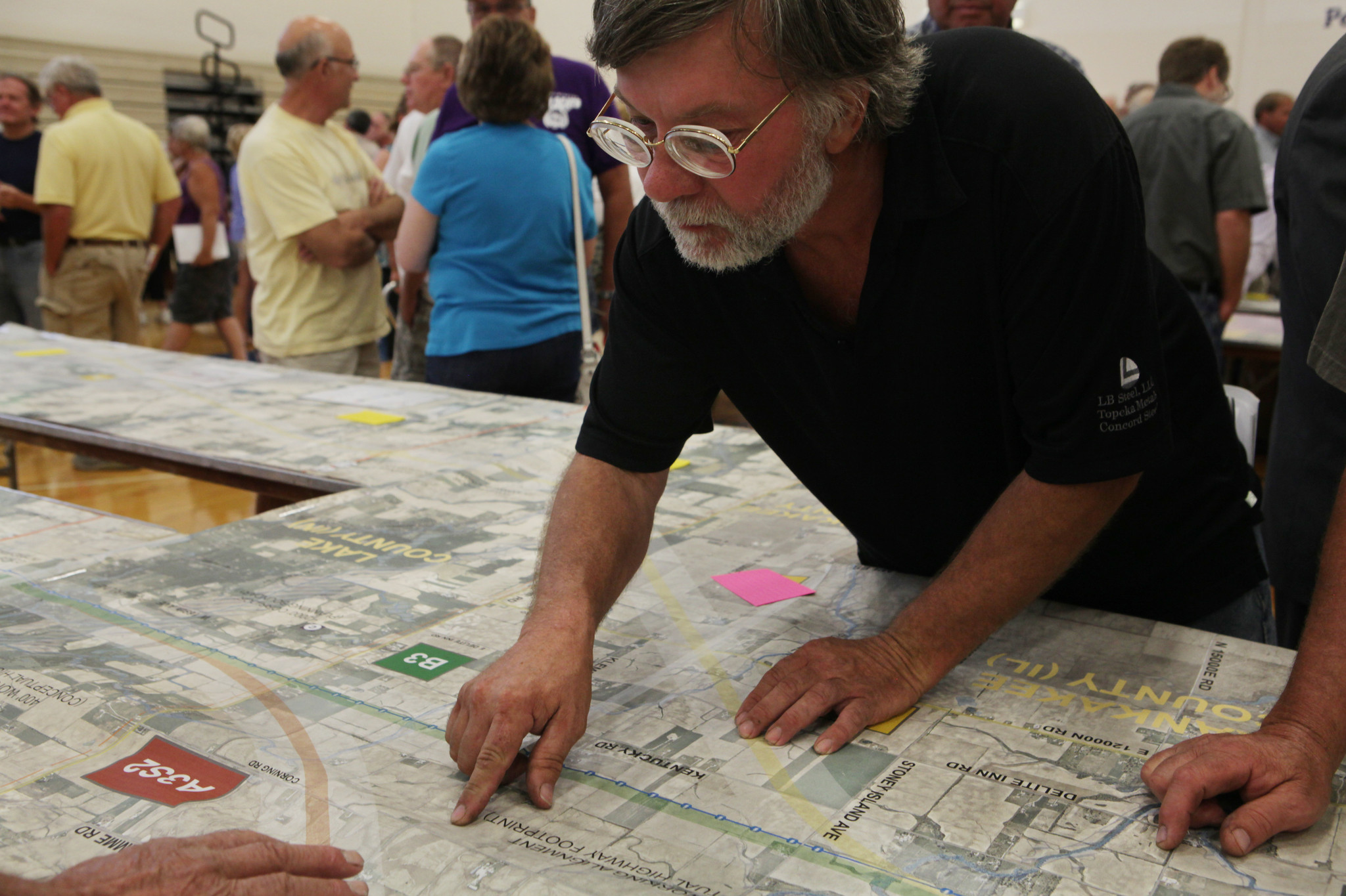 Chris Persch looks at a map outlining part of the environmental impact statement for the proposed Illiana toll road at a public meeting at Peotone High School in Peotone on July 31.