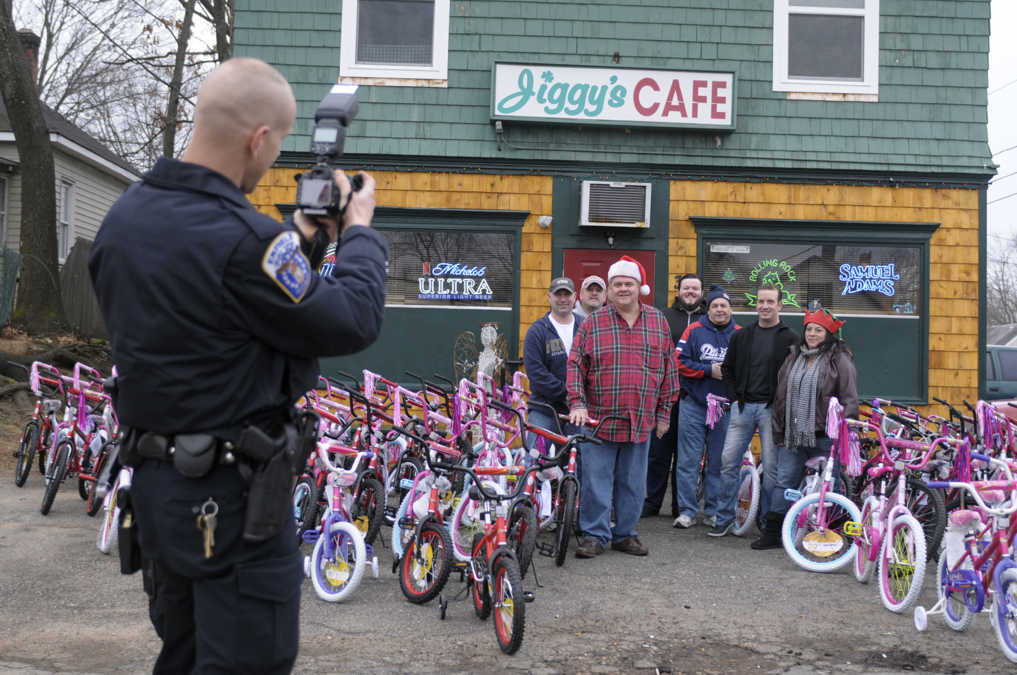 Toys For Joy : Local bar donates bikes in toys to annual