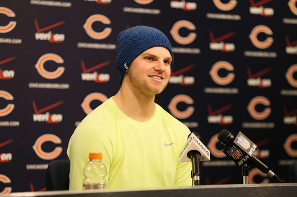 Bears starting quarterback Jimmy Clausen answers questions following practice at Halas Hall.