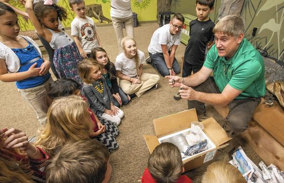 Brady Barr talks with a group of children Wednesday about the hatchling diamondback terrapins newly arrived at EcoAdventures in Millersville.