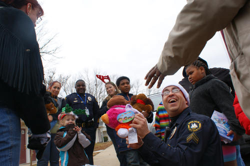 Christmas Toys For The Needy : Kids cicle around james city police officers and other