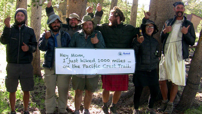 Hikers on the Pacific Crest Trail celebrate their milestone near Hank Magnuski's pop-up cafe east of the Bay Area. Magnuski offers them coffee, cake and fresh fruit as they emerge from a rigorous 300-mile stretch. Photo: Hank Magnuski