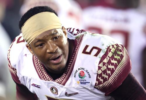 A dejected FSU quarterback Jameis Winston tries to inspire teammates in the FSU bench area late in the game during the Rose Bowl College Football Semifinal game of Florida State versus Oregon at the Rose Bowl stadium in Pasadena, California, on Thursday, January 1, 2015. Oregon won the game 59-20. (Stephen M. Dowell/Orlando Sentinel)