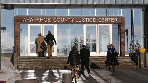 People enter the Arapahoe County Justice Center in Centennial, Colo., on Jan. 20, 2015.