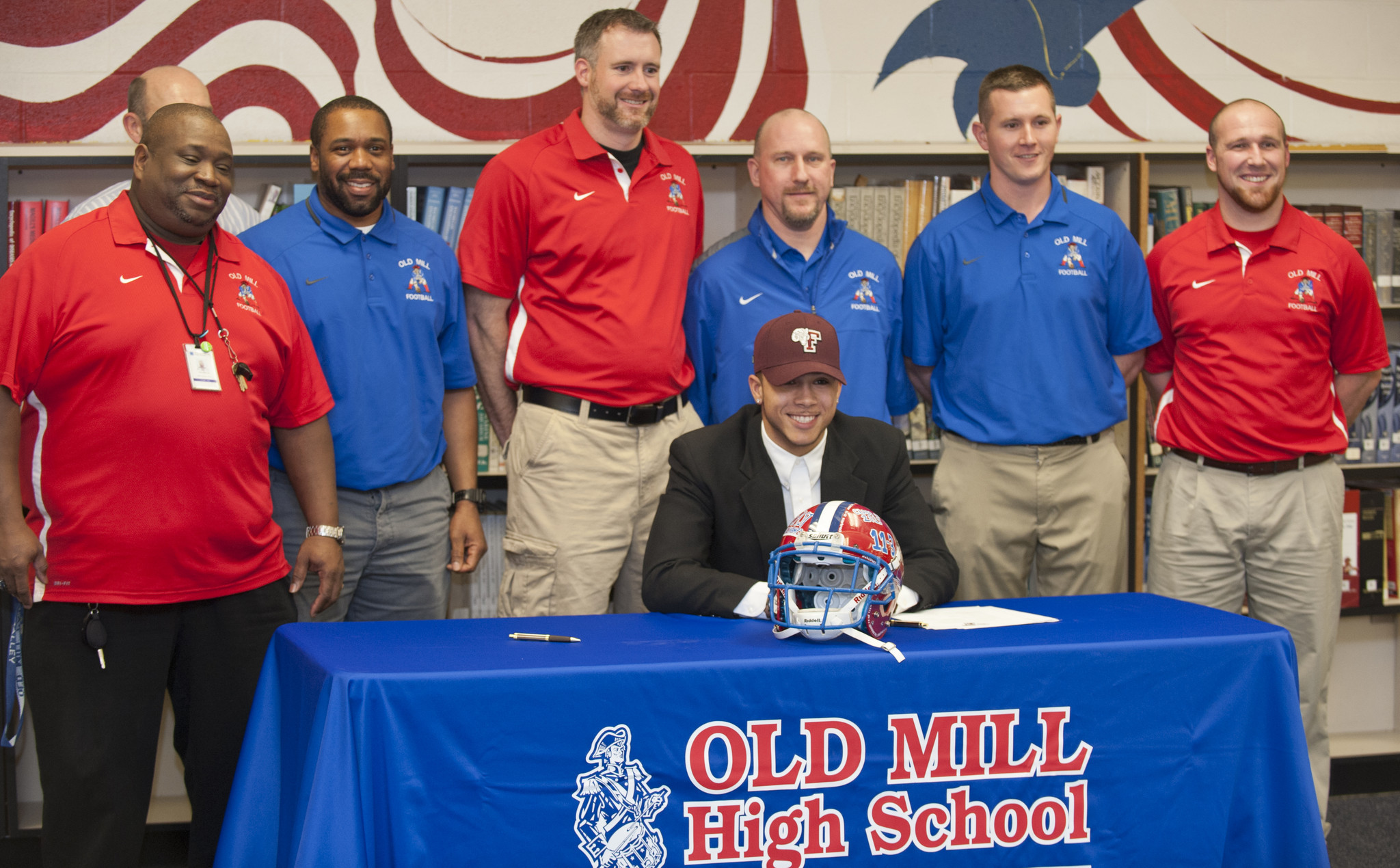 signing day old mill fb athletes