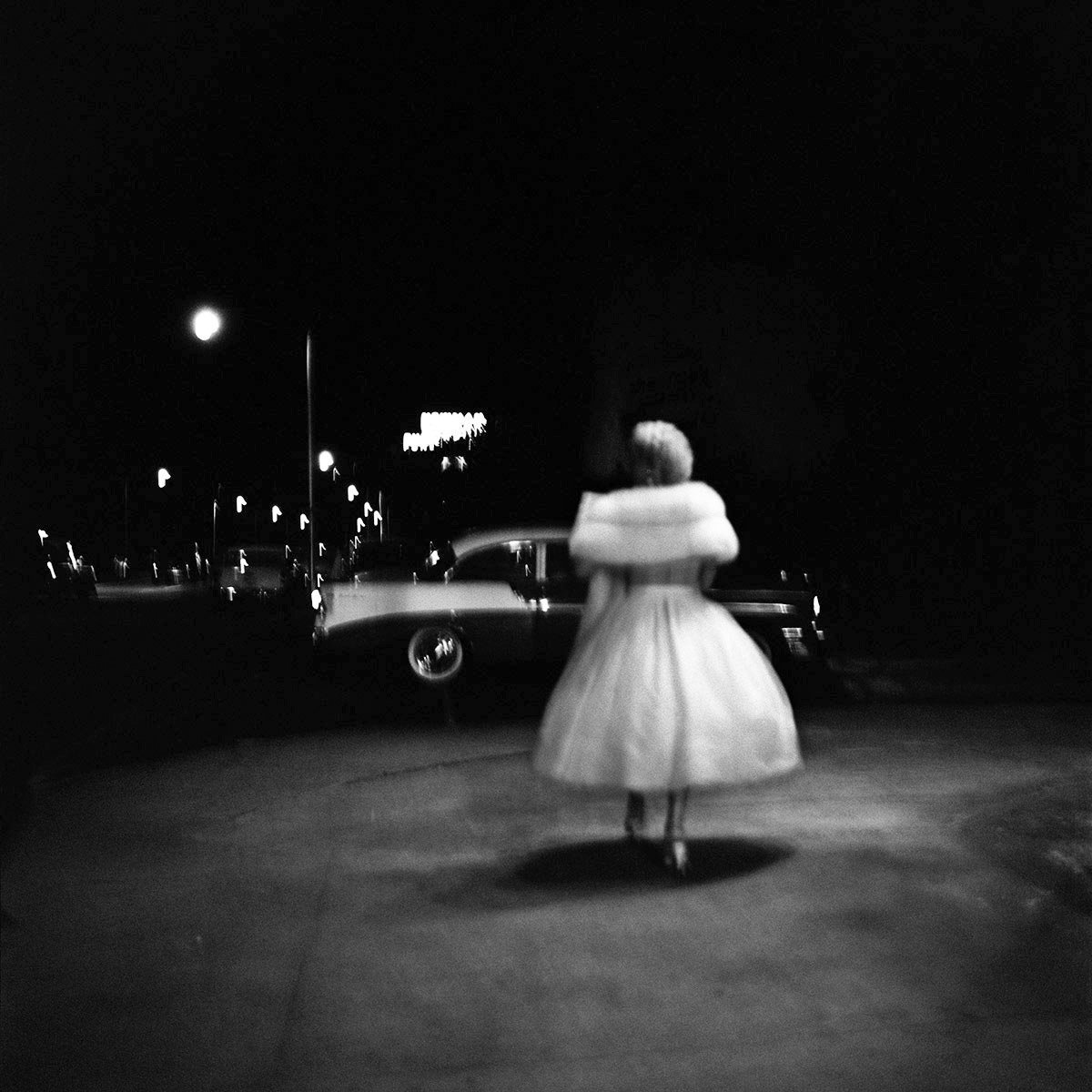 Woman in white by Vivian Maier