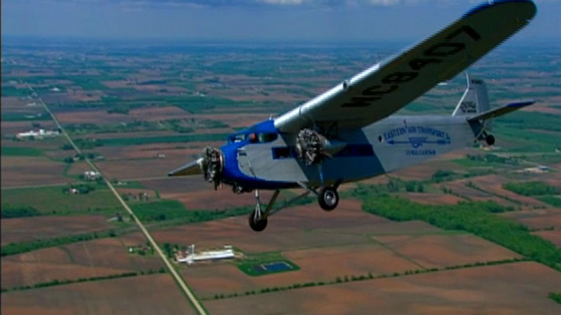 Historic Ford Tri Motor Lumbering Into South Florida Sun