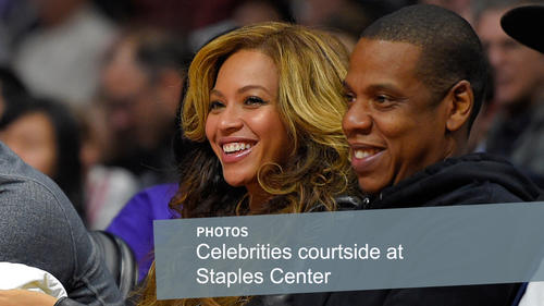 Recording artists Beyonce, left, and Jay-Z watch the Clippers play the Brooklyn Nets at Staples Center on Jan. 22, 2015.